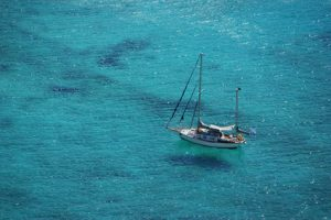 yacht sailing in the Mediterranean sea - little ship surrounded by clear blue waters